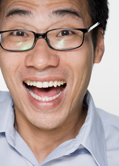 Smiling man wearing glasses.