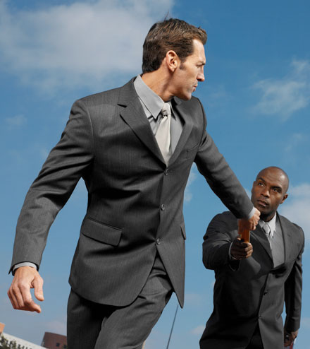 Businessmen handing off a baton.