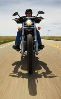 Man on a motorcycle on the open road.
