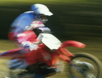 Rider on a fast-moving dirtbike