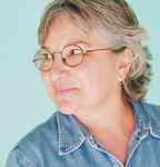 Woman with glasses and grey hair.